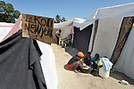 Hundreds of earthquake survivors are huddled in tents and makeshift shelters in a soccer stadium in the Santa Teresa area of Petionville, Haiti, but being victims doesn't mean they've lost their sense of identity. They have named the narrow passages between their shelters with street names. Hundreds of thousands of Haitians were left homeless by the January 12 quake.