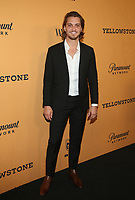 LOS ANGELES, CA - JUNE 11: Luke Grimes, at the premiere of Yellowstone at Paramount Studios in Los Angeles, California on June 11, 2018. <br /> CAP/MPI/FS<br /> &copy;FS/MPI/Capital Pictures