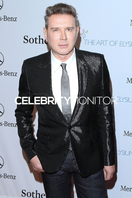 "HOLLYWOOD, LOS ANGELES, CA, USA - FEBRUARY 26: Eugene Sadovoy at The Art Of Elysium's 7th Annual ""Pieces Of Heaven"" Charity Art Auction held at Siren Studios on February 26, 2014 in Hollywood, Los Angeles, California, United States. (Photo by David Acosta/Celebrity Monitor)"
