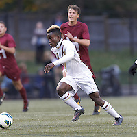Boston College midfielder Derrick Boateng (10) on the attack. Boston College (white) defeated Harvard University (crimson), 3-2, at Newton Campus Field, on October 22, 2013.
