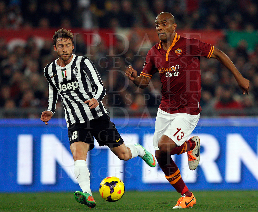 Calcio, quarti di finale di Coppa Italia: Roma vs Juventus. Roma, stadio Olimpico, 21 gennaio 2014.<br /> AS Roma defender Maicon, of Brazil, is challenged by Juventus midfielder Claudio Marchisio, left, during the Italian Cup round of eight final football match between AS Roma and Juventus, at Rome's Olympic stadium, 21 January 2014.<br /> UPDATE IMAGES PRESS/Riccardo De Luca