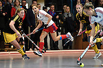 Mannheim, Germany, January 24: During the 1. Bundesliga Damen Hallensaison 2014/15 quarter-final hockey match between Mannheimer HC (white) and Harvestehuder THC (black) on January 24, 2015 at Irma-Roechling-Halle in Mannheim, Germany. Final score 2-3 (2-2). (Photo by Dirk Markgraf / www.265-images.com) *** Local caption *** Charlotte van Bodegom #14 of Mannheimer HC