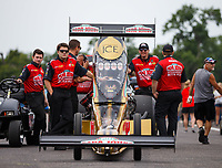 Aug 20, 2017; Brainerd, MN, USA; NHRA top fuel driver Leah Pritchett with crew members during the Lucas Oil Nationals at Brainerd International Raceway. Mandatory Credit: Mark J. Rebilas-USA TODAY Sports