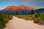 Dirt road below Mount Shasta Volcano at sunset, Cascade Range, Siskiyou County, California