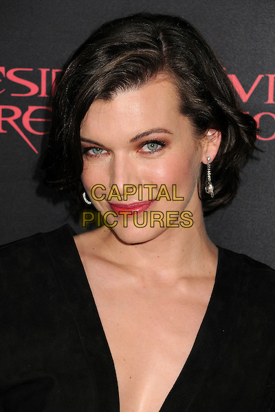 "Milla Jovovich.""Resident Evil: Retribution"" Los Angeles Premiere held at Regal Cinemas L.A. Live, Los Angeles, California, USA..September 12th, 2012.headshot portrait black .CAP/ADM/BP.©Byron Purvis/AdMedia/Capital Pictures."