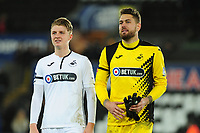 George Byers and Kristoffer Nordfeldt of Swansea City applauds the fans at the final whistle during the FA Cup Fifth Round match between Swansea City and Brentford at the Liberty Stadium in Swansea, Wales, UK. Sunday 17 February 2019