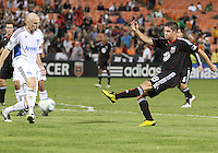 Devon McTavish #18 of D.C. United blasts the ball past Tim Ward #20 of the San Jose Earthquakes during an MLS match at RFK Stadium in Washington D.C. on October 9 2010. San Jose won 2-0.