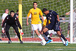 Torrance, CA 02/23/11 - Jared Allen (Tesoro #00) drives the ball to center as West's Scott Bower (West #15) defends him and goal keeper Tom Coleman (West #1) keeps a watchful eye on the action.
