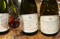 bottles on a barrel in the cellar for wine tasting dom rossignol trapet gevrey-chambertin cote de nuits burgundy france