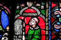 Abbot SUGER presenting a window, c. 1081-1151 founder of Saint Denis cathedral in 1137, statesman and historian, fragment of The Tree of Jesse window, stained glass window in ambulatory, Abbey church of Saint Denis, Seine Saint Denis, France. Picture by Manuel Cohen