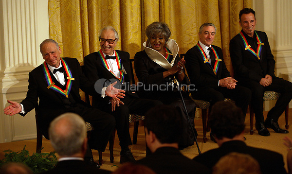 Washington, DC - December 6, 2009 -- Fellow recipients of the 2009 Kennedy Center Honors react to Mel Brooks (left) during an East Room reception in the White House in Washington, D.C., Sunday, December 6, 2009. Shown (l-r) are Mel Brooks, Dave Brubeck, Grace Bumbry, Robert DeNiro, and Bruce Springsteen. <br /> Credit: Martin H. Simon / Pool via CNP /MediaPunch