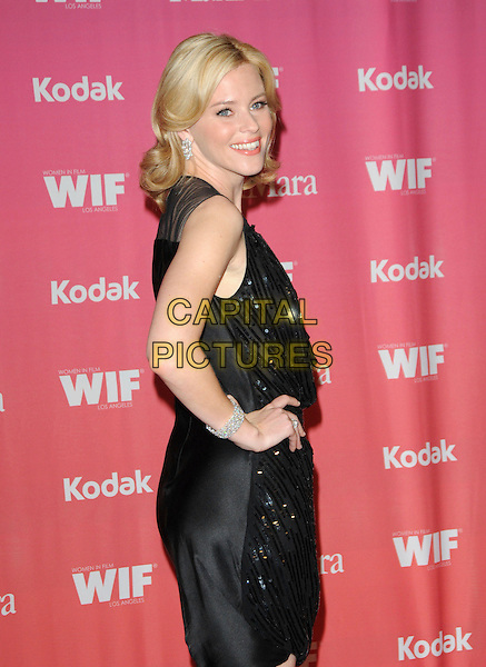 ELIZABETH BANKS .at The Women in Film 2009 Crystal .and Lucy Awards held at The Hyatt Regency Century Plaza in Century City, California, USA, June 12th 2009                                                                     .half  back over shoulder length sleeveless  hand on hip black mesh beaded sequined .CAP/DVS.©Debbie VanStory/RockinExposures/Capital Pictures