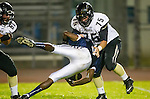Lawndale, CA 10/18/13 - Nathaniel Vaughn  (Leuzinger #3) and Mike Pettis (Peninsula #75) in action during the Peninsula vs Leuzinger Varsity football game at Leuzinger High School.