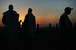 Religious Jews are seen praying at sunrise, during the Birkat Hama prayer. The prayer, which celebrates creation, is said once every 28 years all over Israel on high points,  allegedly at the exact moment when the solar system is alligned exactly as it was at the moment of the creation of the Universe. Photo By : Emil Salman / JINI