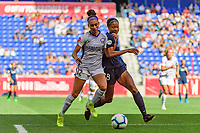 HARRISON, NJ - SEPTEMBER 29: Kristen Edmonds #12 of the Orlando Pride is defended by Imani Dorsey #28 of Sky Blue FC during a game between Orlando Pride and Sky Blue FC at Red Bull Arena on September 29, 2019 in Harrison, New Jersey.