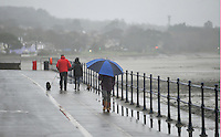 Swansea, Wales :- Friday 23rd January 2015 ... <br /> <br /> Walkers brave the wet windy weather in Mumbles , Swansea during a miserable January.