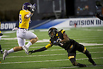 SALEM, VA - DECEMBER 16:  Carson Embry (88) of the University of Mary Hardin-Baylor eludes Cameron Brown (14) of the University of Wisconsin-Oshkosh during the Division III Men's Football Championship held at Salem Stadium on December 16, 2016 in Salem, Virginia.   Mary Hardin-Baylor defeated the University of Wisconsin-Oshkosh 10-7 for the national title. (Photo by Don Petersen/NCAA Photos via Getty Images)