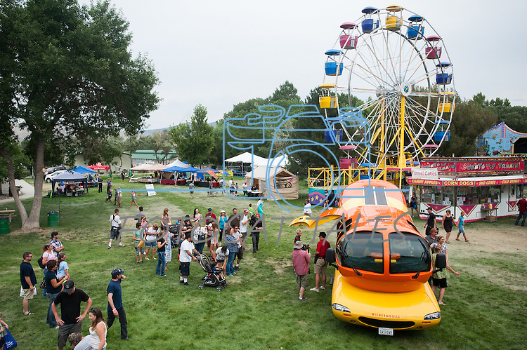 The Oscar Mayer Wienermobile is surrounded by people during the NV150 Fair at Fuji Park in Carson City, Nev., on Sunday, August 3, 2014.<br /> (Photo By Kevin Clifford)
