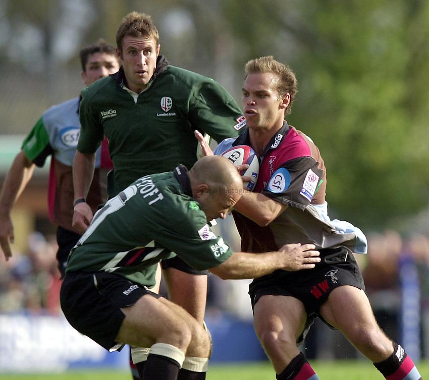 Photo. Richard Lane.NEC Harlequins v London Irish. Zurich Premiership. 21-09-2002.Nathan Williams attacks as Mark Mapletoft tackles.