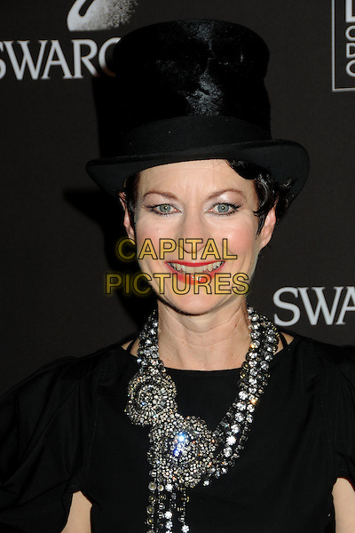 LOU EYRICH .Attending the 12th Annual Costume Designers Guild Awards held at the Beverly Hilton Hotel.  .Beverly Hills, California, USA,  .25th February 2010 .arrivals portrait headshot black hat smiling  necklace  make-up red lipstick .CAP/ADM/BP.©Byron Purvis/AdMedia/Capital Pictures.