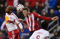 Eriq Zavaleta (22) of Chivas USA goes up for a header with Thierry Henry (14) of the New York Red Bulls. The New York Red Bulls and Chivas USA played to a 1-1 tie during a Major League Soccer (MLS) match at Red Bull Arena in Harrison, NJ, on March 30, 2014.