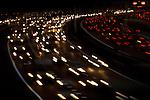 Een stroom verkeer bestaande uit auto's, vrachtwagens en trucks trekken lichtsporen over het asfalt op de snelweg A12 bij Utrecht. COPYRIGHT TON BORSBOOM
