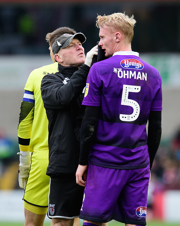 Grimsby Town's Ludvig Ohman receives treatment for an injury<br /> <br /> Photographer Chris Vaughan/CameraSport<br /> <br /> The EFL Sky Bet League Two - Lincoln City v Grimsby Town - Saturday 19 January 2019 - Sincil Bank - Lincoln<br /> <br /> World Copyright &copy; 2019 CameraSport. All rights reserved. 43 Linden Ave. Countesthorpe. Leicester. England. LE8 5PG - Tel: +44 (0) 116 277 4147 - admin@camerasport.com - www.camerasport.com