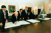 "Israeli and Palestinian leaders sign the maps that were part of the ""Oslo 2"" agreement on 28 September, 1995.  This part of the signing took place in the Cabinet Room at the White House. (L-R) Unidentified Israeli; Israeli Prime Minister Yitzak Rabin; Egyptian President Hosni Mubarak; U.S. President Bill Clinton; King Hussein of Jordan; Palestinian Authority Chairman Yassir Arafat; and unidentified Palestinian..Mandatory Credit: Barbara Kinney - White House via CNP."