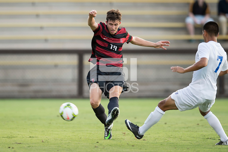 STANFORD, CA - August 19, 2014: Stanford forward Bobby Edwards (19) scores the only goal of the game during the Stanford vs CSU Bakersfield men's soccer match in Stanford, California. Final score, Stanford 1, CSU Bakersfield 0.