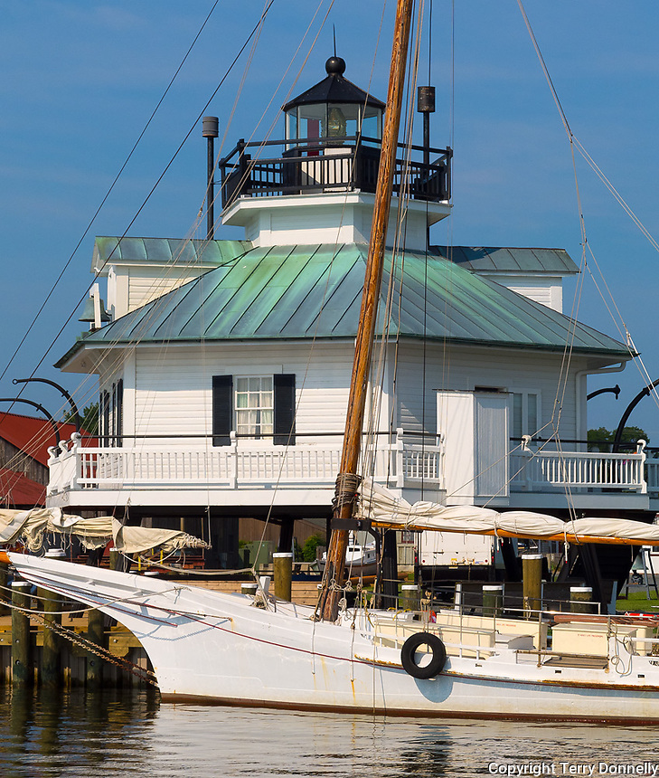 Chesapeake Bay Maritime Museum, St. Michaels, Maryland<br /> Hooper Strait Lighthouse (1879) stands behind the skipjack sloop HM Krent on Navy Point