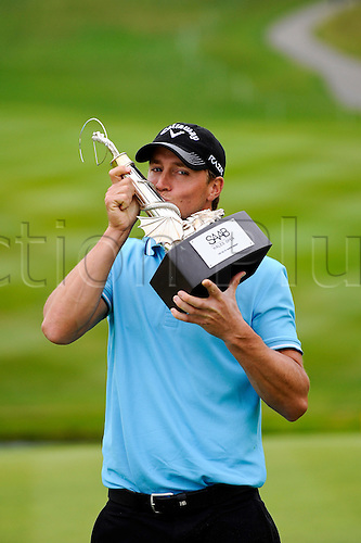 05.06.2011 Day four of the SAAB Wales Open Golf from Celtic Manor. Alexander NOREN (SWE) celebrates victory in the event by kissing the trophy after finishing the tournament on 9 under par after the fourth and final round on the Twenty Ten course.
