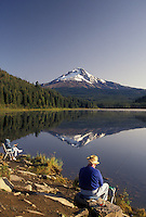 AJ3739, Mount Hood, mirror, fishing, Oregon, A senior couple fishes on the shore of Tillium Lake with the snow covered Mt. Hood reflecting in the calm waters in Mount Hood National Forest in the state of Oregon.