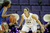 SEATTLE, WA - DECEMBER 18: Washington's #10 Kelsey Plum sets up on defense against Savannah State.  Washington won 87-36 over Savannah State at Alaska Airlines Arena in Seattle, WA.