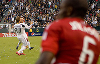 LA Galaxy midfielder David Beckham hammers home a goal past FC Dallas defender Jackson Goncalves (6) and celebrates with teammate Todd Dunivant. The LA Galaxy defeated FC Dallas 2-1 at Home Depot Center stadium in Carson, California on Sunday October 24, 2010.