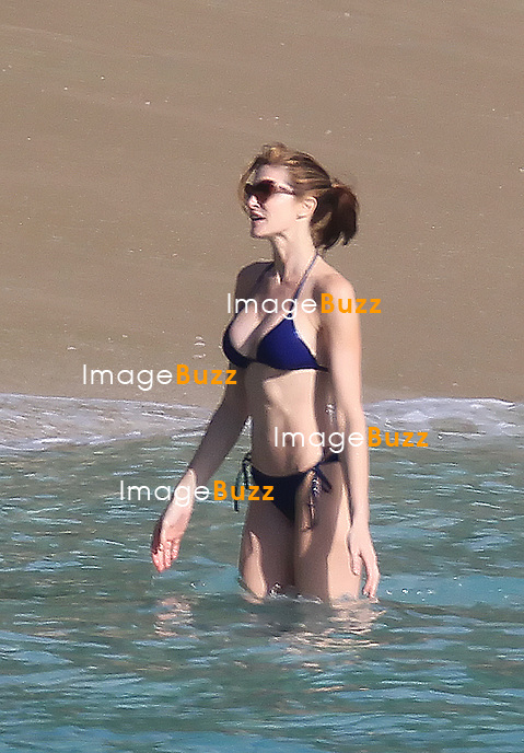 STEPHANIE SEYMOUR - Top model Stephanie Seymour shows off her fit  body while enjoying some vacation on the beach in St Barths with daughter Lily and son Harry. December 22, 2012.