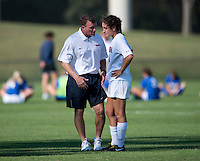 Virginia head coach Steve Swanson talks to Molly Menchel (13) after the game at Klockner Stadium in Charlottesville, VA.  Virginia defeated Duke, 1-0.