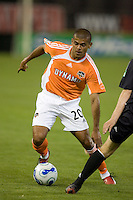 Ronald Cerritos sidesteps a United defender. D.C. United defeated the Houston Dynamo 2-0 at RFK Stadium in Washington, D.C. on April 15, 2006