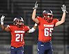 Nolan Hinphy #65, right, and Connor Cassidy #21 of Cold Spring Harbor react after quarterback Teddy Bentley #12 (not in picture) scored a touchdown on a keep late in the second quarter of the Nassau County Conference IV varsity football semifinals against Carle Place-Wheatley at Hofstra University on Thursday, Nov. 9, 2017.