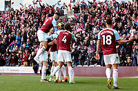 Chris Wood is mobbed by team-mates as he celebrates scoring his sides second goal <br /> <br /> Photographer Rich Linley/CameraSport<br /> <br /> The Premier League - Saturday 13th April 2019 - Burnley v Cardiff City - Turf Moor - Burnley<br /> <br /> World Copyright © 2019 CameraSport. All rights reserved. 43 Linden Ave. Countesthorpe. Leicester. England. LE8 5PG - Tel: +44 (0) 116 277 4147 - admin@camerasport.com - www.camerasport.com