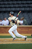 Bruce Steel (17) of the Wake Forest Demon Deacons follows through on his swing against the Miami Hurricanes at David F. Couch Ballpark on May 11, 2019 in  Winston-Salem, North Carolina. The Hurricanes defeated the Demon Deacons 8-4. (Brian Westerholt/Four Seam Images)