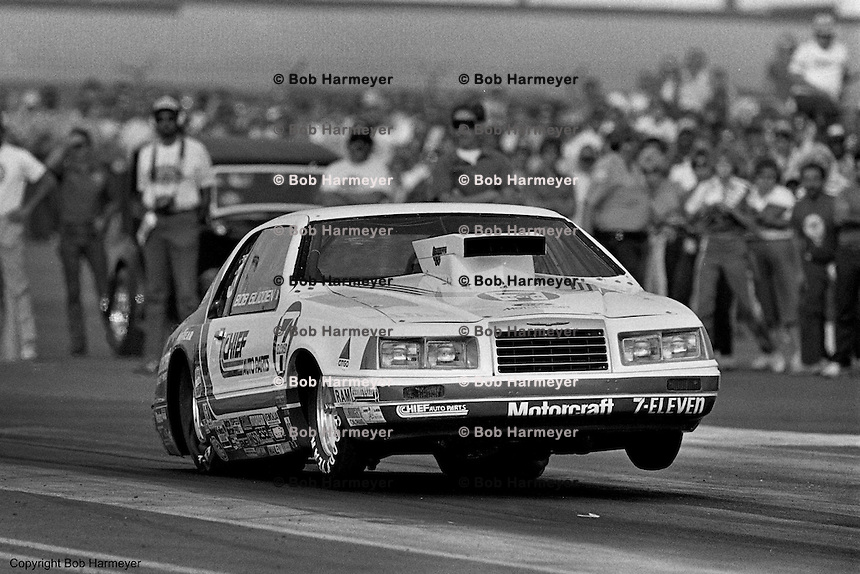 POMONA, CALIFORNIA: Bob Glidden drives his Ford Thunderbird Pro Stock car during a 1985 NHRA drag race at Pomona, California.