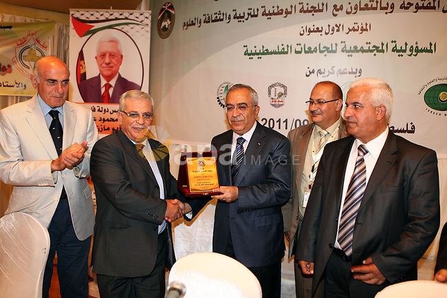 Palestinian Prime Minister, Salam Fayyad during the opening of the social responsibility of the Palestinian universities conference, where organized by Al-Quds Open University in the West Bank city of Nablus on Sept. 26, 2011  Photo by Mustafa Abu Dayeh