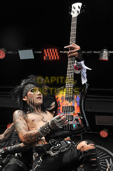 BLACK VEIL BRIDES.Bassist ASHLEY PURDY of the band BLACK VEIL BRIDES performs as part of the Rock On The Range festival held at Columbus Crew Stadium, Columbus, Ohio, USA..May 21st, 2011.stage concert live gig performance music half length black make-up tattoos bass guitar chest topless .CAP/ADM/JN.©Jason L Nelson/AdMedia/Capital Pictures.