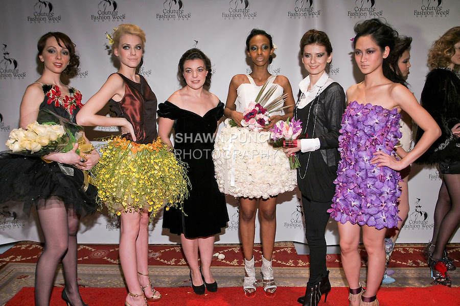 """(l-r) Era Chorna, Jaqueline Backer, Lena Yelagina, Caaha Xaashi, Olga Meshcheryakova, and Elizabeth ThuyTien pose on the red carpet after the Alaric Design Floral Concept Dress """"Arrangement Collection"""" fashion show, during Couture Fashion Week Fall 2011."""