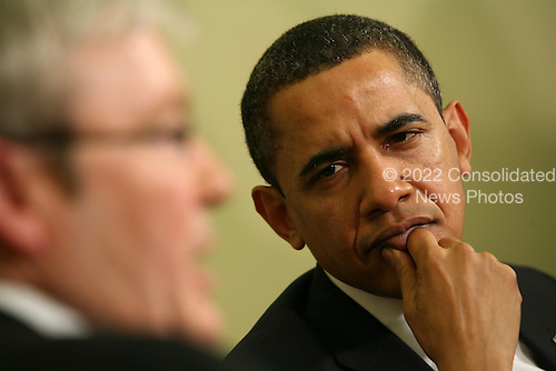 Washington, DC - March 24, 2009 -- United States President Barack Obama meets with Prime Minister of Australia Kevin Rudd in the Oval office of the White House.  President Obama then walked Prime Minster Rudd to his car as he left the White House. .Credit: Gary Fabiano - Pool via CNP