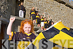 Sadhbh Stack flys the flag for Dr Crokes as she prepares their support ahead of the County final against Austin Stacks this Sunday with back l-r: Ella Galvin, Caoilinn O'Donoghue, Pia Hickey, Niamh stack, Kate Stack, Fiona Galvin and Aine O'Connor