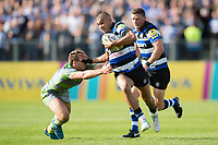 Jonathan Joseph of Bath Rugby fends Craig Willis of Newcastle Falcons. Aviva Premiership match, between Bath Rugby and Newcastle Falcons on September 23, 2017 at the Recreation Ground in Bath, England. Photo by: Patrick Khachfe / Onside Images