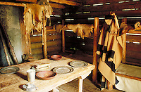interior view of historic bunkhouse at Fort Clatsop showing blankets, furs and utensils. Fort Clatsop Oregon USA.