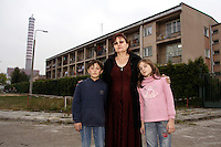 Chechen woman, use to be a lawyer before, in Chechnya, alone, with her two children, outside the URiC Moszna Center..On the background - the former Moszna Workers Hotel, rented by URiC for the Center of Asylum Seekers..-For security reason, the names of the adult asylum seeker have been change. .-Article 9 of the Act of 13 June 2003 on grating protection on the Polish territory (Journal of Laws, No 128, it. 1176) personal data of refugees are an object of particular protection..-Cases where publication of a picture or name of asylum seeker had dramatic consequences for this persons and is family back in Chechnya. .Please have safety of those people in mind. Thank you.