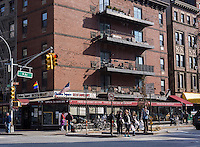 Pedestrians cross Ninth Avenue at West 23rd Street in Chelsea in New York on Saturday, March 22, 2014. (© Richard B. Levine)